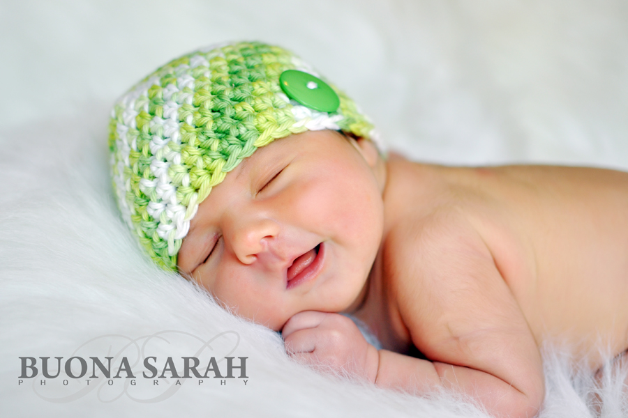 smiling newborn with tulsa photographers